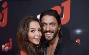 Nabilla Benattia et son fiancé Thomas Vergara lors d'une présentation de leur programme de télévision, le 21 octobre 2013 à Paris