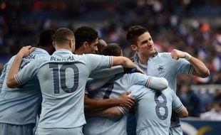 Leader du groupe I avec deux points d'avance sur l'Espagne, la France va aborder en position de force et avec certains atouts le grand choc de mardi contre la Roja même si l'inefficacité chronique de Karim Benzema a de quoi contrarier Didier Deschamps.