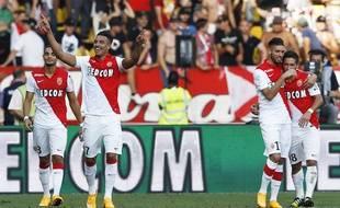 Nabil Dirar (au premier plan), Yannick Ferreira Carrasco et Joao Moutinho fêtent un but contre Guingamp, le 21 septembre 2014.