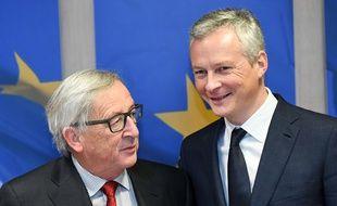 Jean-Claude Juncker et Bruno Le Maire (à d.), à Bruxelles, le 5 décembre 2017.