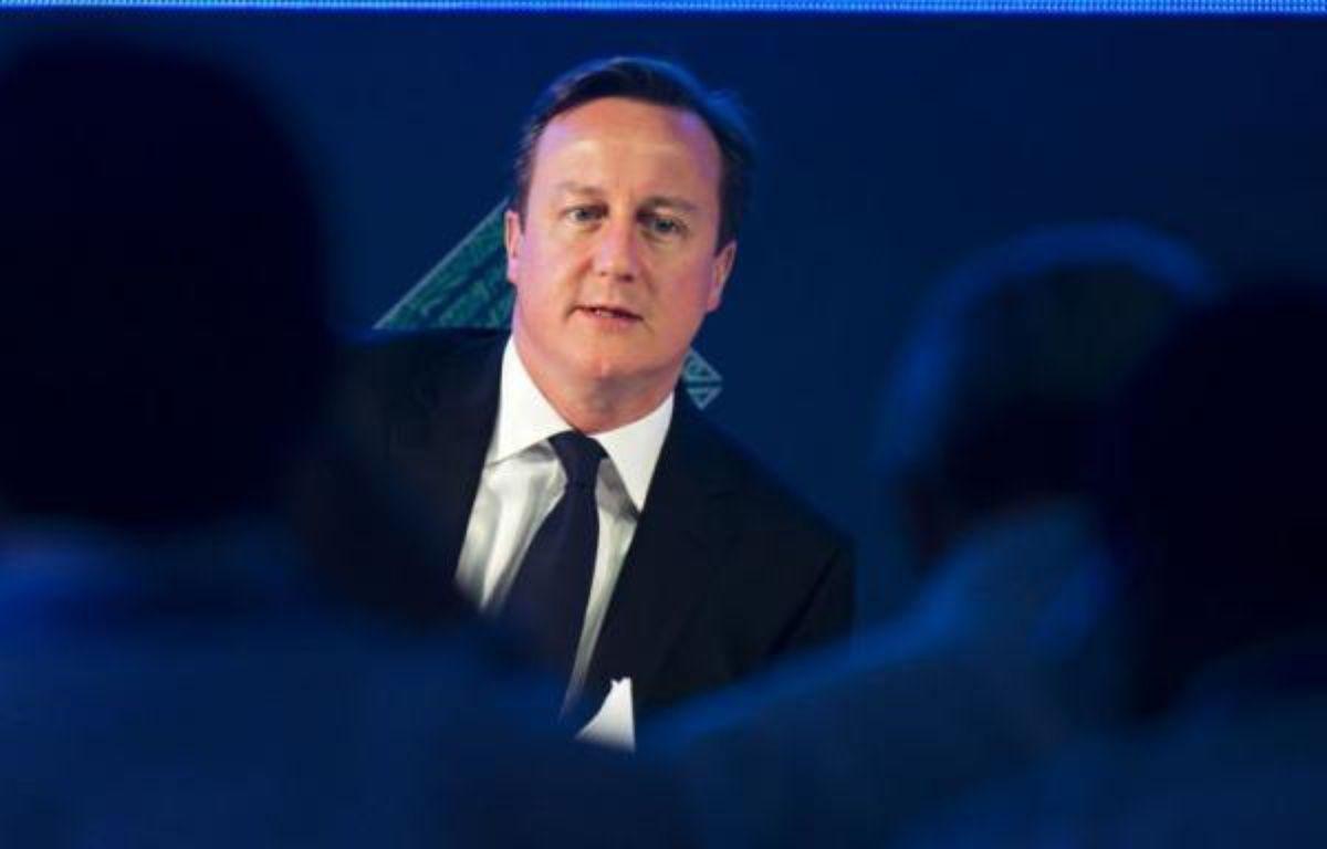 Le Premier ministre britannique David Cameron s'est dit prêt lundi à accueillir les entreprises qui fuieraient l'impôt en France, après avoir critiqué le projet du président français François Hollande de relever l'imposition des contribuables les plus riches. – Omar Torres afp.com
