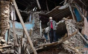 A Nepalese villagers stands in the rubble of damaged homes at Kritipur at the Kathmandu Valley on May 2, 2015. Nepal has ruled out the possibility of finding more survivors buried in the rubble from a massive earthquake that killed more than 6,700 people and devastated vast swathes of one of Asia's poorest countries. AFP PHOTO/MENAHEM KAHANA
