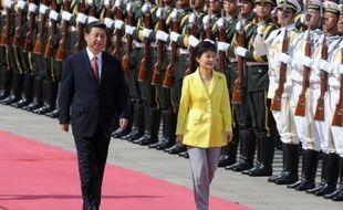 La Chine et la Corée du Sud veulent oeuvrer à la dénucléarisation de la péninsule coréenne, a déclaré jeudi le président chinois Xi Jinping en rencontrant son homologue sud-coréenne, Mme Park Geun-Hye.