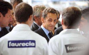 La visite de Nicolas Sarkozy dans une usine Faurecia à Caligny (Orne) le 3 septembre 2009 est soupçonnée par la télé belge RTBF d'avoir été bidonnée.