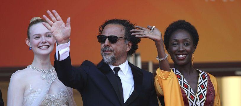 Les jurés Elle Fanning, Alejandro Gonzalez Inarritu et Maimouna N'Diaye le 25 mai à Cannes