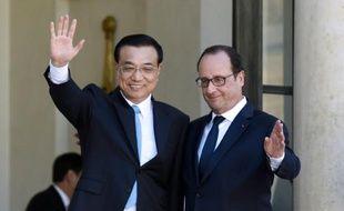 Le président français François Hollande et le Premier ministre chinois Li Keqiang à l'Elysée, le 30 juin 2015 à Paris