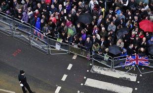 Les premiers spectateurs s'étaient rassemblés mercredi matin dès 06H30 (07H30 GMT) dans le centre de Londres pour être aux premières loges des funérailles de Margaret Thatcher.