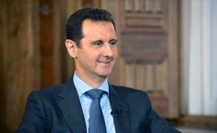 Image fournie par l'agence officielle syrienne SANA du président syrien Bachar al-Assad, le 26 août 2015 à Damas
