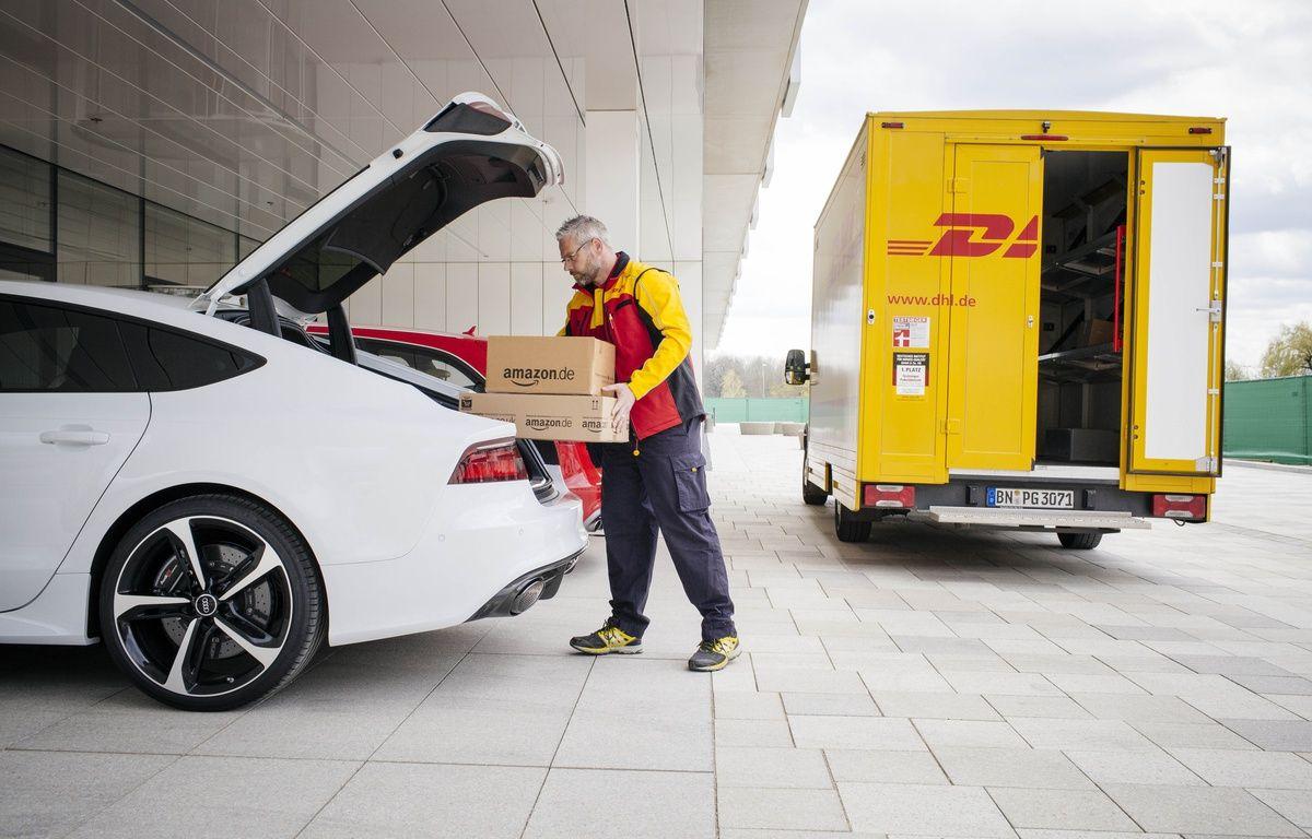 Amazon, Audi et DHL on signé un partenariat pour livrer des colis dans le coffre du véhicule du client. – AMAZON