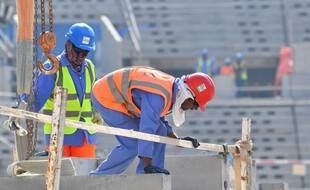 Des ouvriers sur un chantier du Mondial 2022, à Doha, au Qatar.