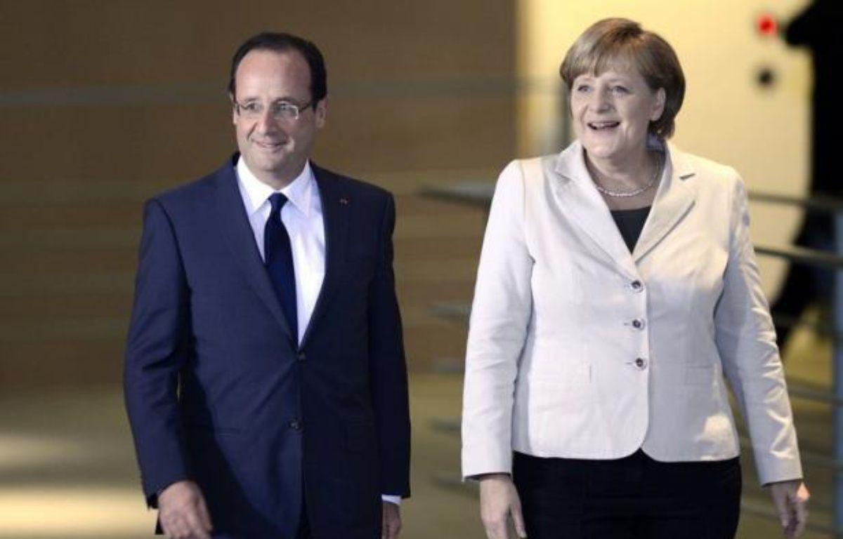 La chancelière allemande Angela Merkel et le président français François Hollande tenteront d'afficher leur unité jeudi à Berlin lors d'un sommet déterminant pour l'avenir de la Grèce dans la zone euro. – Odd Andersen afp.com