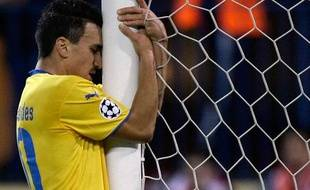 1re journée, gr. D  Atlético Madrid - Apoel Nicosie: 0-0  Les joueurs de l'Apoel Nicosie se sont accrochés jusqu'au bout pour conserver leur premier point en Ligue des champions, mardi soir.