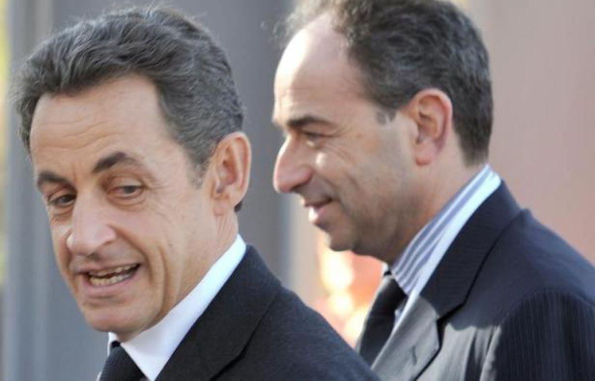 Le 8 décembre 2011 à Marseille, l'ex-président français Nicolas Sarkozy (g) et le président de l'UMP Jean-Francois Copé – Gerard Julien AFP