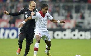 Arjen Robben et Franck Beria lors du match de Ligue des champions Bayern Munich-Lille (LOSC), le 7 novembre 2012.