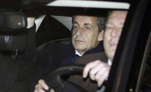 Nicolas Sarkozy quitte le pôle financier du palais de justice de Paris le 16 février 2016.