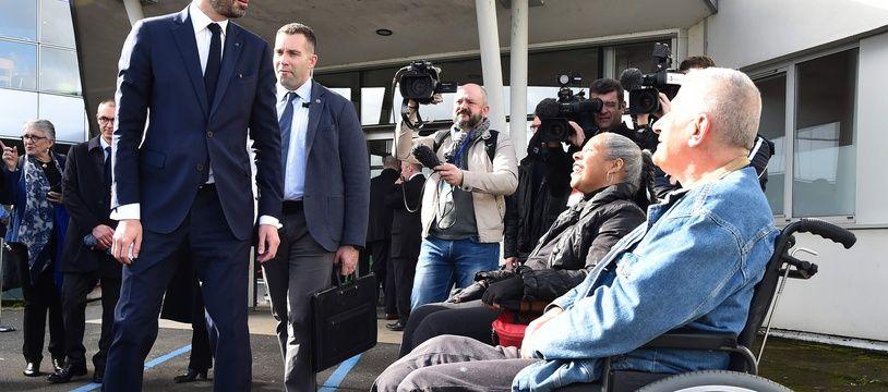 Le Premier ministre Edouard Philippe en visite au  Centre de l'Arche à Saint-Saturnin le 16 mars 2018 / AFP PHOTO / JEAN-FRANCOIS MONIER