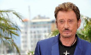 Johnny ne se séparait jamais de son pendentif préféré.