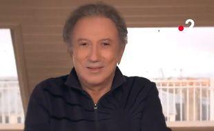 Michel Drucker annonce son retour à l'antenne dans un spot diffusé sur France 2 en mars 2021.