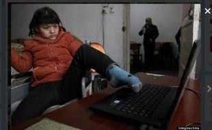 Hu Huiyuan, victime de paralysie cérébrale. Et écrivain.