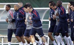 Patrice Evra etFrranck lors d'un entraînement de l'équipe de France, le 21 mars 2011, à Clairefontaine.