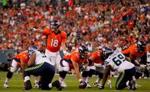 Peyton Manning (N°18, orange) face aux Seahawks, en 2013