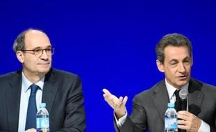 Eric Woerth et Nicolas Sarkozy au conseil national du parti Les Républicains le 13 février 2016 à Paris