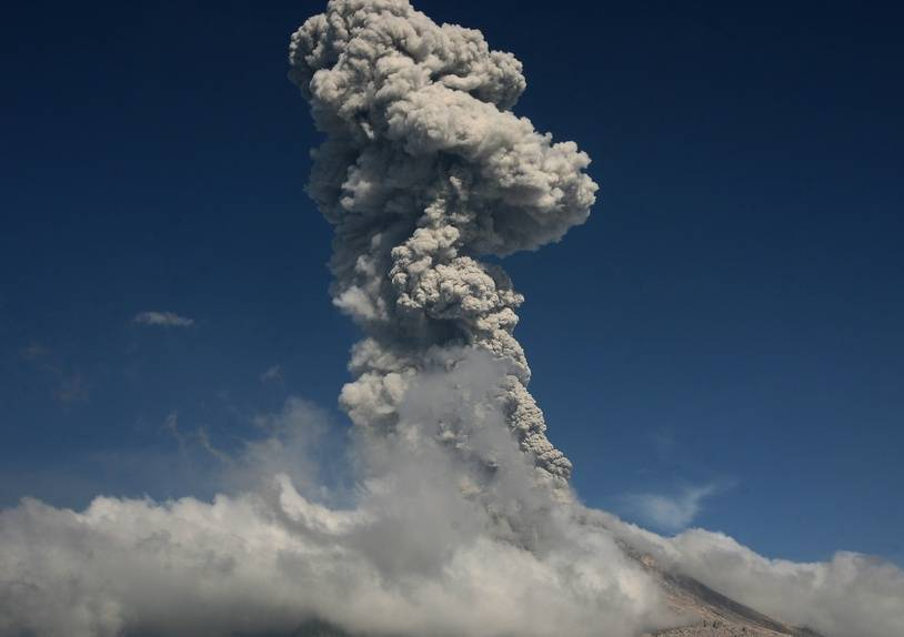 Mount Sinabung volcano spews smoke and ash into the air in Karo, North Sumatra on January 18, 2018. The volcano, which roared back to life in 2010 after four centuries of silence, has been erupting steadily since 2015, displacing more than 3,000 families.