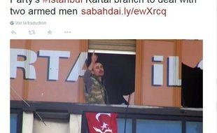 Un des deux hommes armés qui s'est introduit dans un local de l'AKP