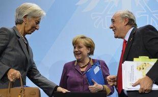 La chancelière allemande Angela Merkel et les grandes organisations économiques mondiales ont appelé mardi à Berlin à poursuivre les réformes pour sortir d'une situation économique toujours morose.