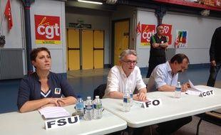 Bernadette Groison, de la FSU, Jean-Claude Mailly, de FO, et Philippe Martinez, de la CGT, au meeting de l'intersyndicale opposée à la loi travail, le 6 juillet 2016 au gymnase Japy à Paris.