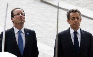 François Hollande et Nicolas Sarkozy lors des cérémonies du 8 mai 2012.