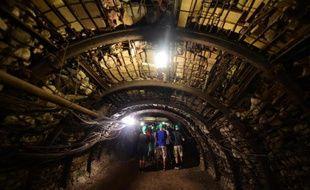 """Des visiteurs du """"Musée de la mine"""" à Cagnac-les-Mines, près de Carmaux, le 24 juillet 2014"""