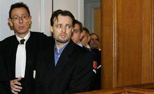 Stéphane Breitwieser arrive en compagnie de son avocat Me Thierry Moser, le 6 janvier 2005 au tribunal correctionnel de Strasbourg, pour l'ouverture de son procès pour le vol de 23 œuvres d'art en France, au Danemark et en Autriche.