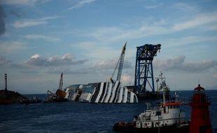 Ingénieurs, techniciens, ouvriers, plongeurs: ils sont venus du monde entier pour relever un des plus grands défis de l'histoire maritime, débarrasser l'île du Giglio (Toscane) de l'épave du Costa Concordia, qui y a fait naufrage le 13 janvier dernier.