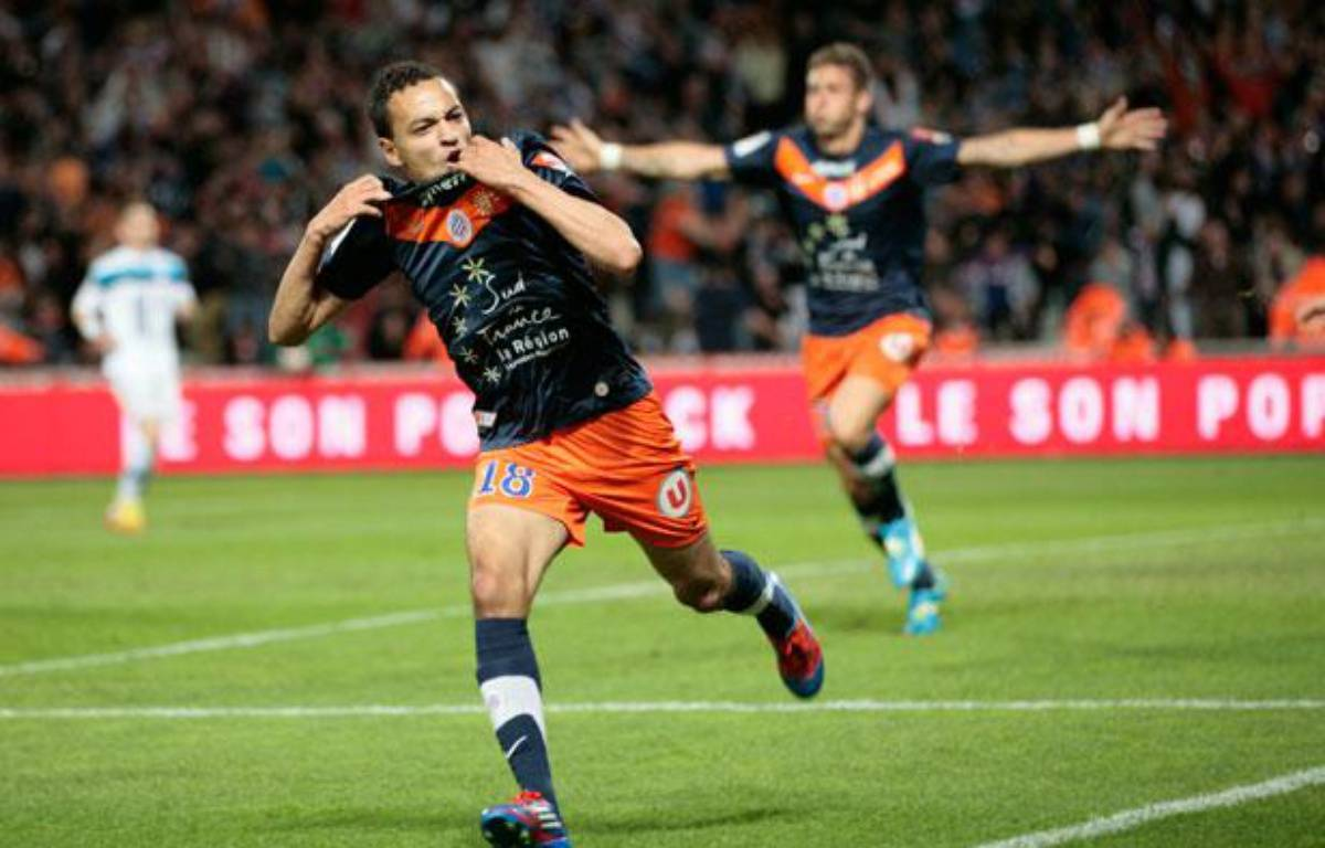 Karim Aït Fana auteur d'un but à Montpeklllier suivi d'Olivier Giroud, auteur de la passe décisive lors de la 37e journée de Ligue 1. – Pascal Parrot / Reuters