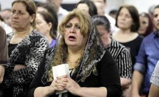 Des chrétiens d'Irak qui ont fui la violence dans leur ville de Mossoul, se sont réfugiés en Jordanie où ils assistent à une messe à Amman le 7 septembre 2014