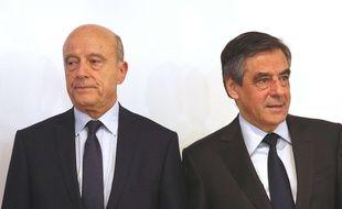 Alain Juppé et François Fillon, le soir de la victoire de François Fillon à la primaire à droite, le 27 novembre 2016 à Paris.