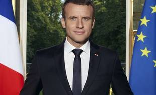 Photo provided by the French Presidential Palace shows the official portrait of the French President Emmanuel Macron in Elysee Palace, Paris, France.