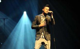 Baptiste Giabiconi sur le scène de l'Olympia, le 15 septembre 2012.