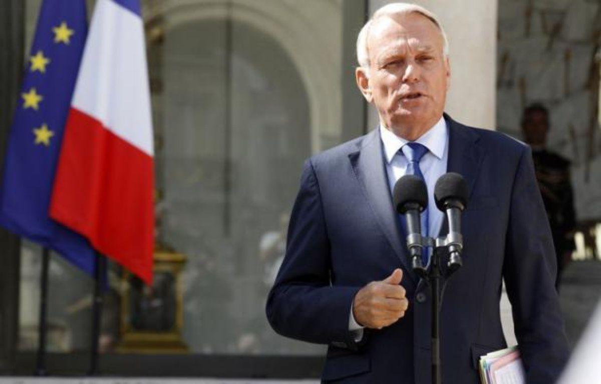 """Les réformes de rentrée annoncées par le premier ministre Jean-Marc Ayrault, qualifiées de """"demi-mesures"""" par certains éditorialistes, n'ont pas provoqué selon eux de """"raz-de-marée d'enthousiasme"""". – Thomas Samson afp.com"""
