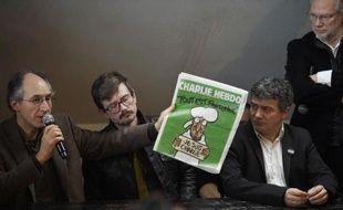 Gérard Briard, Renald Luzier, alias Luz, Patrick Pelloux et Laurent Joffrin, lors de la présentation du numéro de Charlie Hebdo le 13 janvier 2015 à Paris