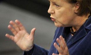 """La chancelière allemande Angela Merkel a estimé mercredi qu'il fallait """"remédier aux imperfections"""" de l'union monétaire européenne """"maintenant ou, je le dis, jamais""""."""