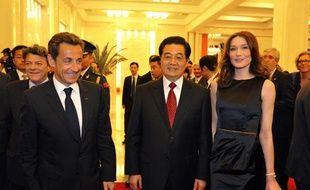 Nicolas Sarkozy et Carla Bruni lors d'un dîner d'Etat, en Chine, mercredi 28 avril 2010.