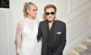 Mandatory Credit: Photo by Swan Gallet/WWD/REX/Shutterstock (5744598o) Laeticia Hallyday and Johnny Hallyday in the front row Christian Dior show, Autumn Winter 2016, Haute Couture Fashion Week, Paris, France - 04 Jul 2016