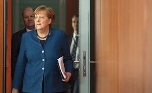 Lorsqu'elle demande à un ministre de prendre la porte, Angela Merkel montre l'exemple