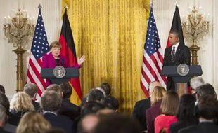 Le président américain Barack Obama et la chancelière allemande Angela Merkel lors d'une conférence de presse commune à la Maison Blanche, le 9 février 2015