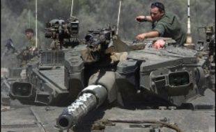 """L'offensive lancée par Israël dans la bande de Gaza semblait marquer le pas mercredi après midi, le Premier ministre Ehud Olmert affichant toutefois sa détermination à user de """"moyens extrêmes"""" pour retrouver son soldat enlevé."""