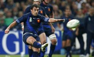 France's Lionel Beauxis kicks the ball during the semi-final Rugby World Cup against England at the Stade de France Stadium in Saint-Denis, near Paris, October 13, 2007.