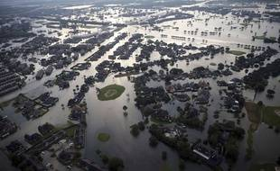 Floodwaters from Tropical Storm Harvey surround homes in Port Arthur, Texas, Thursday, Aug. 31, 2017.