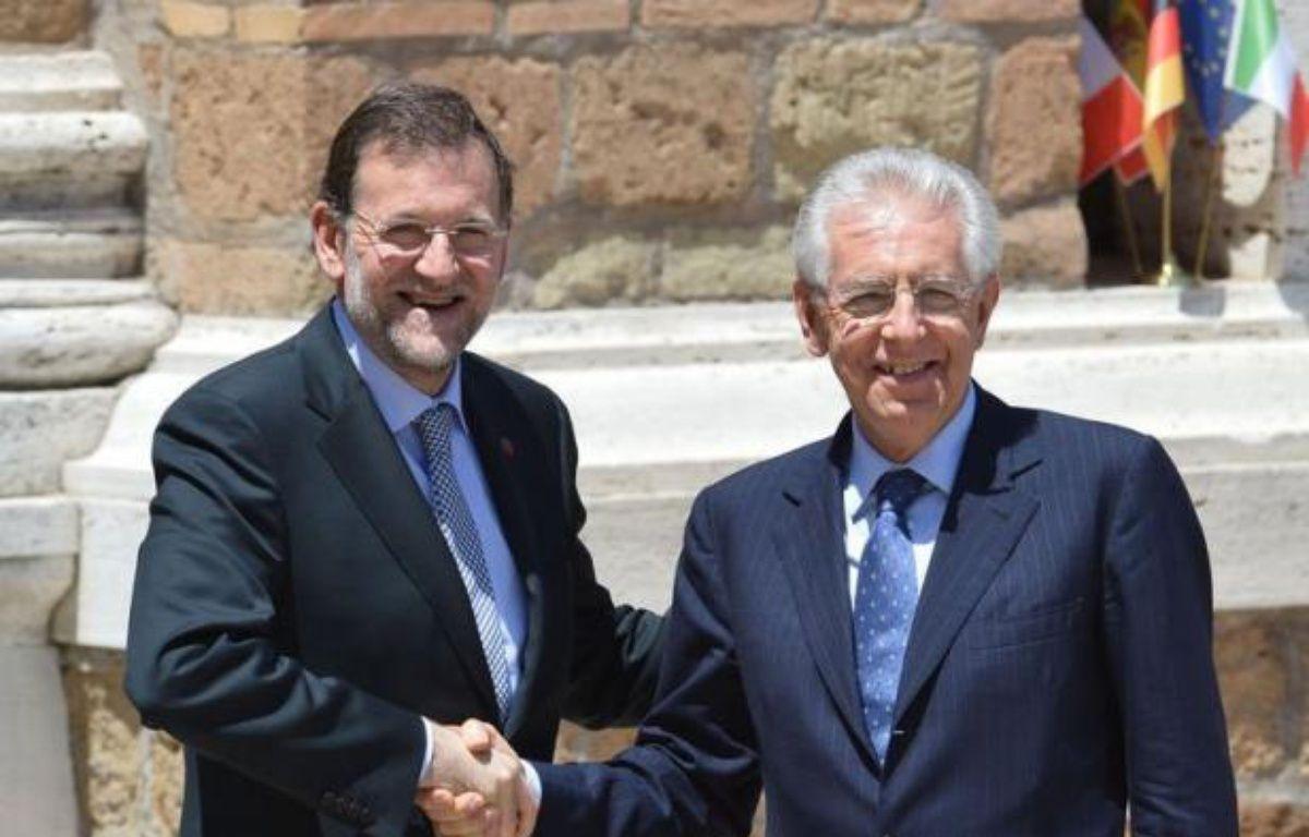 Le mini-sommet entre les dirigeants des quatre principales économies de la zone euro, consacré à la crise de la dette et destiné à préparer le sommet européen crucial des 28 et 29 juin, a démarré vendredi à Rome à 12H15 GMT, a constaté l'AFP. – Alberto Pizzoli afp.com
